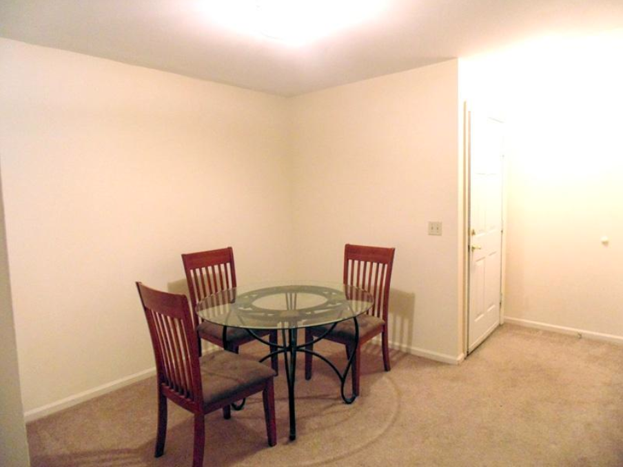 student apartments near suny cortland image of dining table with 3 chairs from sap properties
