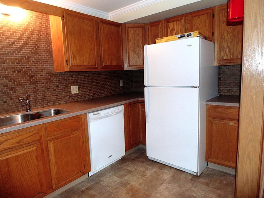student apartments near suny cortland image of kitchen sink and fridge from sap properties