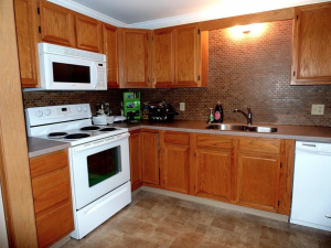 student apartments near suny cortland image of kitchen with oven dishwasher and cabinets from sap properties