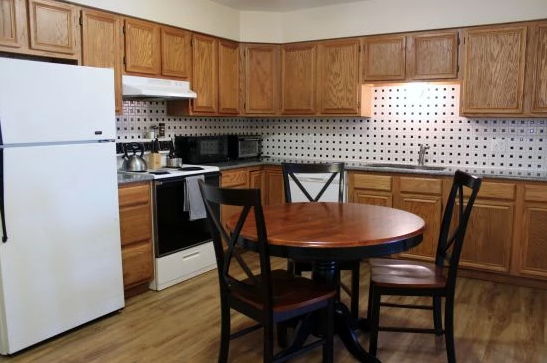 student apartments near suny cortland image of kitchen and dining room table from sap properties